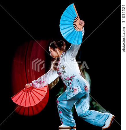 woman Tai Chi Chuan Tadjiquan posture isolated black background light painting 54852525