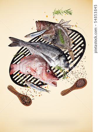 Flying raw sea fish with ingredients for cooking. Food preparation concept 54853845
