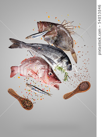Flying raw sea fish with ingredients for cooking. Food preparation concept 54853846