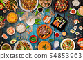 Asian food background with various ingredients on rustic wooden table. 54853963