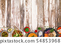 Asian food background with various ingredients on rustic wooden table. 54853968