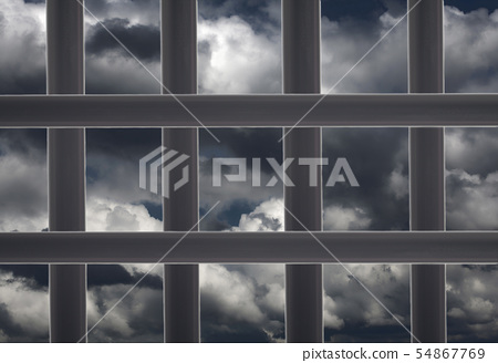 Prison window cell and cloudy sky 54867769