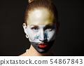 Woman face with painted Iraq Flag 54867843