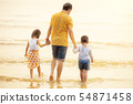 Father And Children  walking into the  Beach 54871458