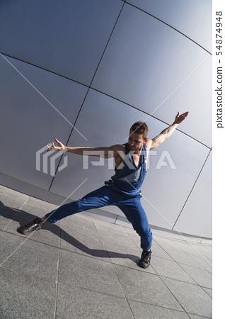Young handsome man street dancer dancing outdoor 54874948