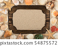 Frame of wood on the sand, stars, shells and 54875572