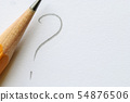 Pencil next to question mark on white paper 54876506