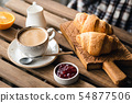 Coffee and croissants for breakfast 54877506