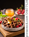 Belgian waffles with honey and sweet cherries 54877528