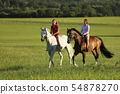 Two young girl riding horses on the walk without 54878270