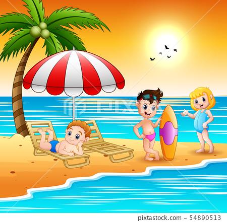 Children enjoying a summer vacation on the beach 54890513