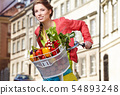 Pretty spring  woman with bicycle and groceries in 54893248