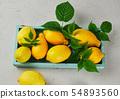 fresh ripe whole yellow lemons on a blue wooden 54893560