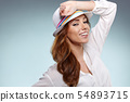 Smiling woman in studio portrait 54893715