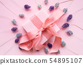 Pink gift box with a pink ribbon . 54895107