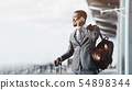 Always in Touch. Entrepreneur Talking on Phone at Airport 54898344