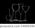 Glassware silhouettes on black. 54899286