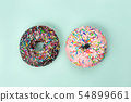 Two tasty doughnuts on turquoise background. 54899661