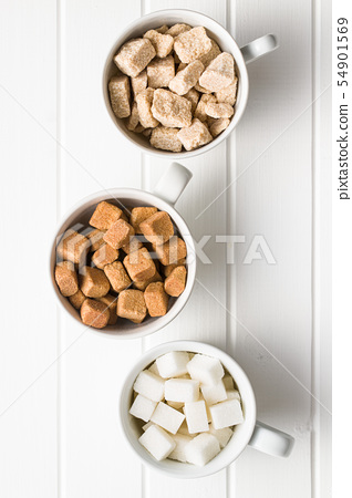 White and brown sugar cubes. 54901569
