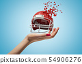 Closeup of woman's hand holding sports helmet which is breaking into small pieces that are flying 54906276