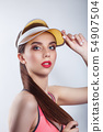 Fashion woman with red lips in pink t-shit and clear visor cap on white background 54907504
