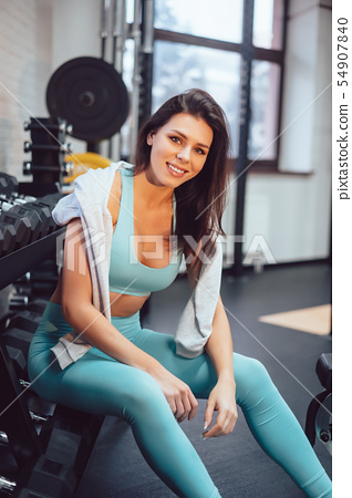 Young adult girl posing on camera in the gym 54907840