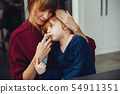 Mother treats her daughter at home 54911351