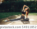 Beautiful sports girl in a summer park 54911852