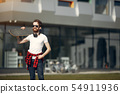 Stylish guy with skate in a summer city 54911936