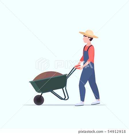 gardener man pushing wheelbarrow loaded with soil male farmer working in garden agriculture 54912918