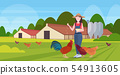 woman farmer feeding chicken and rooster free range poultry breeding farming agriculture concept 54913605