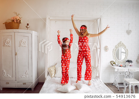 Cute mother and daughter at home in a pajamas 54913676