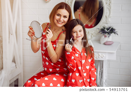 Cute mother and daughter at home in a pajamas 54913701
