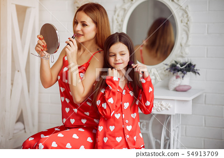 Cute mother and daughter at home in a pajamas 54913709