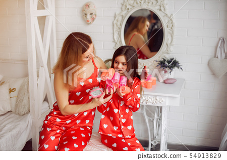 Cute mother and daughter at home in a pajamas 54913829