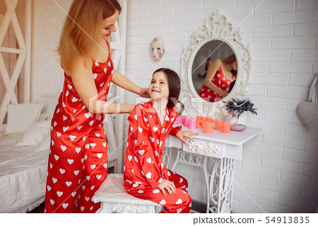 Cute mother and daughter at home in a pajamas 54913835