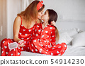 Cute mother and daughter at home in a pajamas 54914230