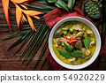 Thai food chicken green curry on wooden table 54920229