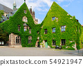 the facade of a building covered with the plant 54921947