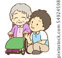 男性看护者谈话与轮椅的年长妇女 54924598