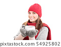 Winter clothes and hot tea 54925802