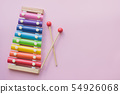 Rainbow Colored Wooden Toy Xylophone on pink bacground. toy glockenspiel made of metal and wood 54926068