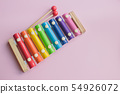 Rainbow Colored Wooden Toy Xylophone on pink bacground. toy glockenspiel made of metal and wood 54926072