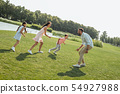 Playing with family. Active and happy young family playing and smiling while spending free time 54927988