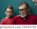 Close-up grandfather and grandson in glasses 54930782