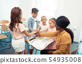 Children and teacher enjoying their team work all together 54935008