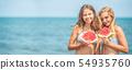 Young beautiful girl eating fresh watermelon on 54935760