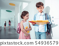 Older brother speaking with his cute little sister at school 54936579
