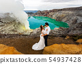 Newlyweds in the crater of a volcano 54937428