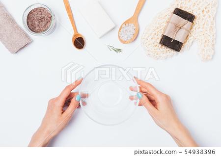Woman making homemade body scrub 54938396